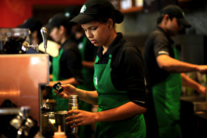 Employees work inside the Starbucks at the Taj Mahal Palace hotel in south Mumbai, India. (Erika Schultz/Seattle Times/MCT)